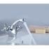 H02-61 Rossinka Смеситель двуручный для умывальника монолитный хром